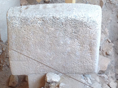 ©K.G. Akoglu. Stone pillar with rounding at the corners, discoloration, biological deposition and pitting